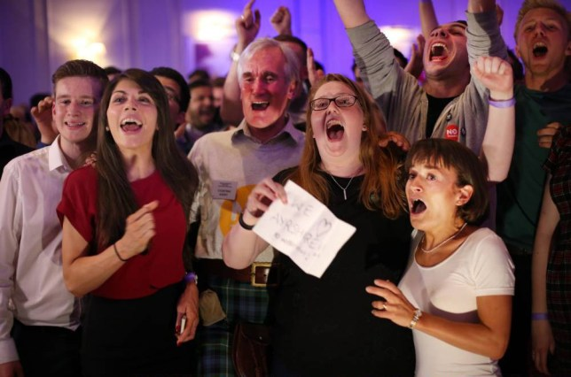 GLASGOW, SCOTLAND - SEPTEMBER 19:  Better Together campaigners celebrate poll results at a party on September 19, 2014 in Glasgow, Scotland. Polls have now closed in the Scottish referendum and the United Kingdom await the results of this historic vote.  With a substantial turnout at the polling stations the vote is too close to call and the result is expected in the early hours of Friday morning  (Photo by Peter Macdiarmid/Getty Images)