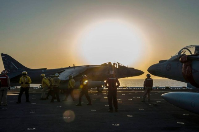 epa04412725 A handout picture released by the US Navy on 23 September 2014 shows an US AV-8B Harrier jet launching from the flight deck of the amphibious assault ship USS Makin Island during flight operations in the Arabian Gulf, 22 September 2014. The Makin Island is deployed in support of maritime and theater security operations in the US Fifth Fleet area of responsibility. The United States and allied forces launched airstrikes against Islamic State (IS) militants in Syrian territory for the first time, the Pentagon said late 22 September 2014. The military was 'using a mix of fighter, bomber and Tomahawk Land Attack Missiles,' in the ongoing operation. The bombings were the first against Islamic State militants in Syria. The US had previously bombed Islamic State targets in Iraq, but said that it would pursue the group in Syria if necessary.  EPA/US NAVY / Christopher Lindahl  Public Affairs Officer USS MAKIN ISLAND smithml@lhd8.navy.mil via DVIDS HANDOUT EDITORIAL USE ONLY