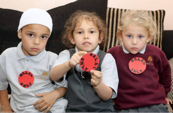 "Picture shows l-r Mohammed Talib 4, Khadija Khan 5 and Tayyeba Khan 3, whose mother Henna Khan 29 has had to resort to putting a 'Halal Only' badge on her children before they go to school to ensure they are not given non Halal school meals. See copy RPYHALAL. A Muslim family have sent their kids to school with ""Halal only"" signs stuck to their chests in protest at their daughter being served non-Halal food on at least SIX different occasions.Dismayed dad Talib Hussain said he was willing to accept the mistake the first time five-year-old Khadija Khan was given the wrong meal, but he has lost confidence that the school will prevent similar mistakes from happening again.This week, Khadija, and her siblings Mohammed Talib, four, and Tayyeba Khan, three, went to Woodside Academy, in Bradford, West Yorks., with the bold message taped to their uniforms to highlight the problem. rossparry.co.uk / Steven Schofield"