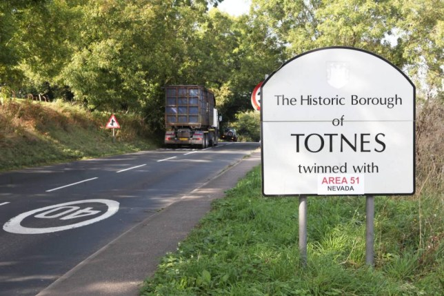 """Totnes twinned - with Area 51. See SWNS story SWTOTNES: A town has received an usual pairing on its 'Welcome' sign after pranksters twinned it - with AREA 51. Residents in Totnes, Devon, had its sign decorated with a sticker proclaiming a twinning with the secret Nevada zone. It is the most recent in a line of unusual pairings for the town - two years ago it was twinned with Narnia. A spokesperson for Totnes town council said: """"As far as I am aware, we are not twinned with Area 51 or Narnia."""""""