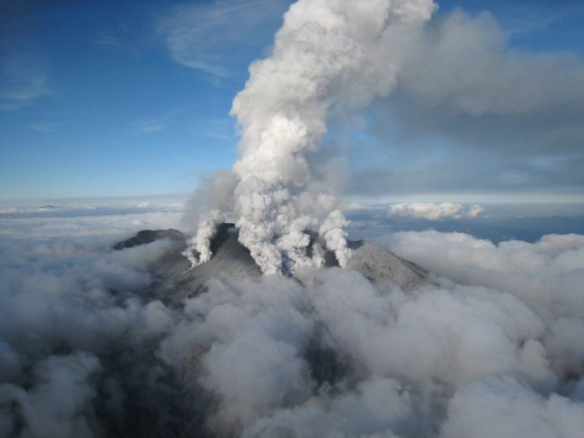 """TOPSHOTS This handout picture taken by Ministry of Land, Infrastructure and Transport Chubu Regional Development Bureau on September 27, 2014 shows white smoke rising from Mount Ontake as Japan's volcano Ontake erupts in Nagano prefecture, central Japan.  Dozens of hikers were stranded on the slopes of an erupting Japanese volcano that has reportedly killed one person and left 30 more seriously injured. The eruption of the 3,067-metre Mount Ontake straddling Nagano and Gifu prefecture happened around midday.   AFP PHOTO / MINISTRY OF LAND, INFRASTRUCTURE AND TRANSPORT CHUBU REGIONAL DEVELOPMENT BUREAU via JIJI PRESS ---EDITORS NOTE---HANDOUT RESTRICTED TO EDITORIAL USE - MANDATORY CREDIT """"AFP PHOTO / MINISTRY OF LAND, INFRASTRUCTURE AND TRANSPORT CHUBU REGIONAL DEVELOPMENT BUREAU via JIJI PRESS"""" - NO MARKETING NO ADVERTISING CAMPAIGNS - DISTRIBUTED AS A SERVICE TO CLIENTS   JAPAN OUTMINISTRY OF LAND, INFRASTRUCTURE/AFP/Getty Images"""