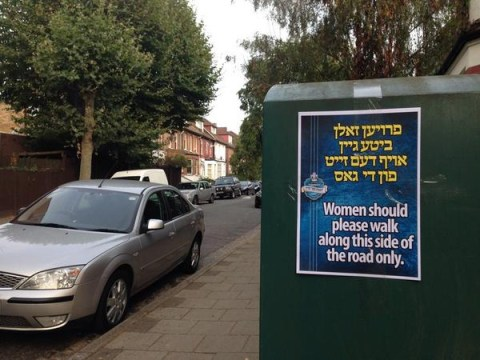 Council removes 'unacceptable' signs telling women to walk on one side of the road following backlash
