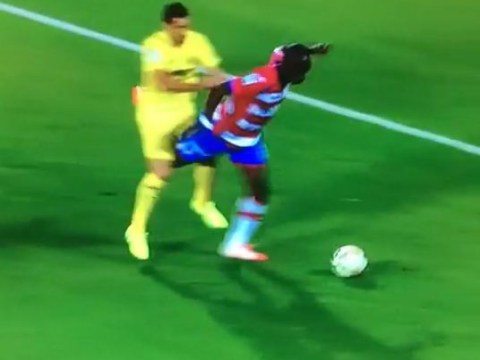 Granada's Allan Nyom draws a ridiculous foul by throwing his leg through opponent's groin