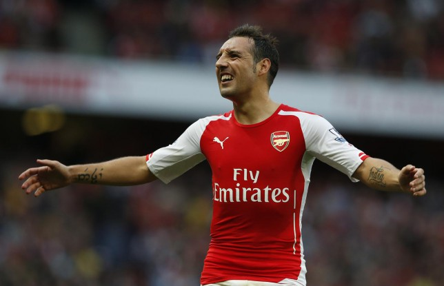 Arsenal's Santi Cazorla reacts in frustration at the slow pace of a throw in, during the English Premier League soccer match between Arsenal and Hull City at the Emirates stadium in London Saturday, Oct.18, 2014. (AP Photo/Alastair Grant) AP Photo/Alastair Grant