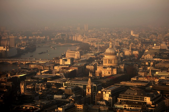 LONDON, ENGLAND - MARCH 05: A view over the financial district and St Paul's Cathedral towards the west of the city at sunrise on March 5, 2013 in London, England. The recent construction of numerous tall buildings on the London skyline has been controversial due to concerns that views of historic landmark buildings, such as St Paul's cathedral, are being obscured. (Photo by Matthew Lloyd/Getty Images)