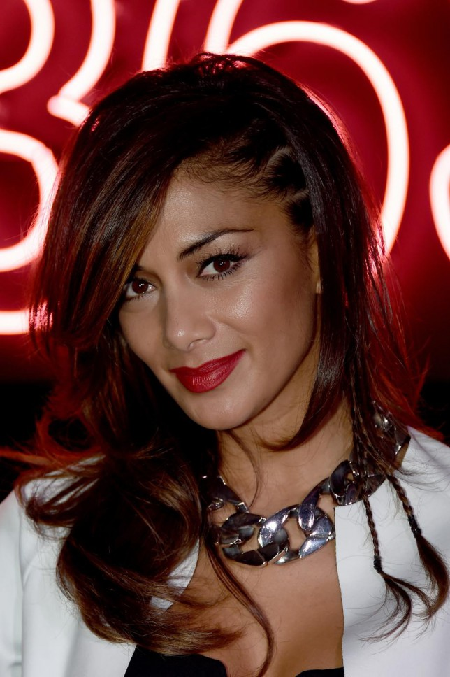 LONDON, ENGLAND - OCTOBER 20: Nicole Scherzinger meets fans and signs copies of her new album 'Big Fat Lie' at HMV, Oxford Street on October 20, 2014 in London, England. Gareth Cattermole/Getty Images