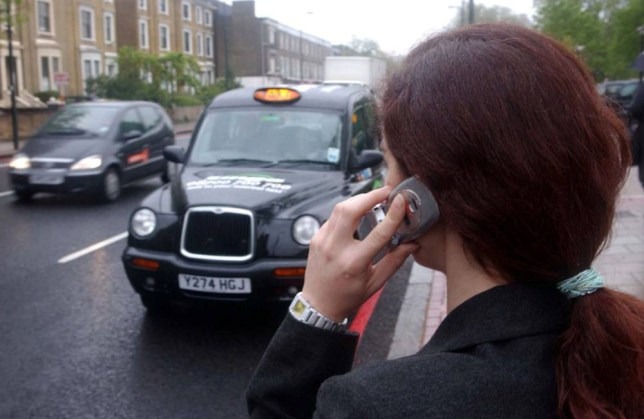 """EMBARGOED TO 0900 MONDAY OCTOBER 6 File photo dated 28/04/2003 of a woman hailing a taxi, as more than 190,000 mobile phones are lost in the back of London taxis each year, in what a security firm has called a technology """"black hole"""". PRESS ASSOCIATION Photo. Issue date: Monday October 6, 2014. Internet security firm ESET surveyed 300 London black cab drivers and found that on average a driver finds around eight forgotten mobile phones in their taxi each year, with around half of them not being secured by any type of pin code or other means, leaving private data vulnerable. See PA story TECHNOLOGY Mobiles. Photo credit should read: Andy Butterton/PA Wire"""