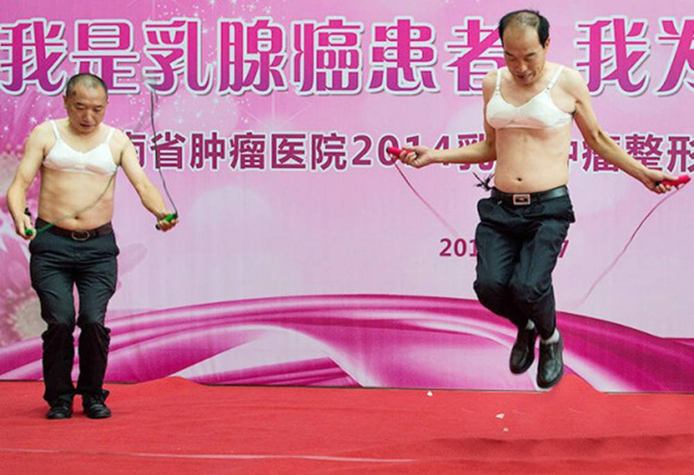 """Pic shows: Men were persuade to wear bras with false breast to show how women suffer after mastectomies.nnCancer campaigners boobed in China when they persuaded middle aged men to wear bras with false breasts to show how women suffer after mastectomies.nnVolunteers were ordered to strip to the waist and strap on the prosthetic bars worn by women who have lost both breasts to cancer.nnThen they were required to perform a series of tasks like carrying buckets of water, mopping the floor and even skipping.nnThe bizarre stunt - in Hunan province in Southern China - was supposed to raise awareness of breast cancer victims.nnBut users of China's biggest social network Weibo dismissed it as """"creepy"""" and """"perverted.""""nnOne - identified on Weibo as LienKo35 - said: """"This is deeply creepy. There is a serious message to deliver about breast cancer in China and they put on what looks like a gimps' convention.""""nnShe added: """"Why not have real women there telling their real stories? Who cares what a middle aged businessman thinks or how he feels.""""nnAnother - named as Zhi Ch'eng - said: """"It looks like a bunch of perverts. This is just sick.""""nnBut Hunan Cancer Hospital - which organised the event - defended the stunt.nnSpokesman Long She said: """"It was intended to be a way to show men how women who've had mastectomies suffer when they're doing ordinary household things day in day out.""""nnHe added: """"We think we put over a serious message in a way people will remember.""""nn(ends)n"""
