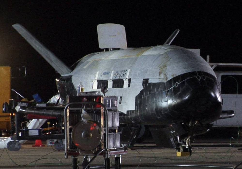 """(FILES) This picture provided by the US Air Force shows the X-37B, the Air Force's first unmanned re-entry spacecraft, after landing on December 3, 2010 at Vandenberg Air Force Base in California.The X-37B is expected to land at Vandenberg Air Force Base in California, the Air Force said. The base did not give an exact time for the landing, but a notice to aviators and mariners on the Federal Aviation Administration's website said airspace around the Southern California base would be closed from 8 am to 5 pm PST October 14, 2014.  AFP PHOTO/US AIR FORCE/FILES == RESTRICTED TO EDITORIAL USE / MANDATORY CREDIT: """"AFP PHOTO / HANDOUT / US Air Force """"/ NO MARKETING / NO ADVERTISING CAMPAIGNS / NO A LA CARTE SALES / DISTRIBUTED AS A SERVICE TO CLIENTS ==Handout/AFP/Getty Images"""