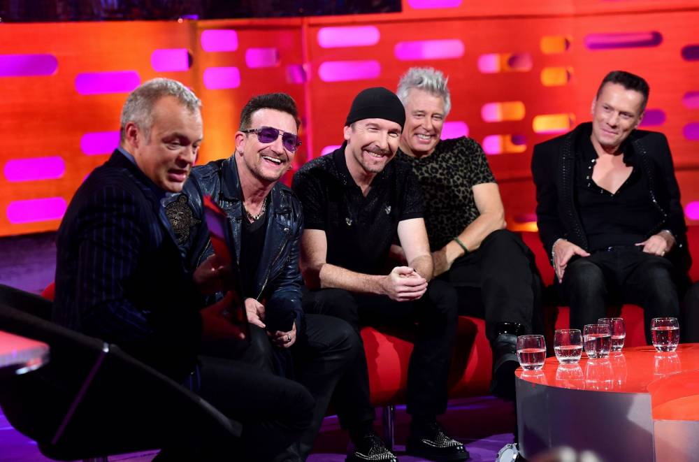 File photo dated 16/10/14 of (left to right) Graham Norton, Bono, The Edge, Adam Clayton and Larry Mullen Jr during filming of the Graham Norton show, where U2 frontman Bono revealed he has suffered from glaucoma for many years, prompting his continual use of dark glasses. PRESS ASSOCIATION Photo. Issue date: Friday October 17, 2014. The star said he has had the condition - a build-up of pressure in the eyeball which can damage the optic nerve and lead to blindness if not treated - for around two decades. See PA story SHOWBIZ Bono. Photo credit should read: Ian West/PA Wire