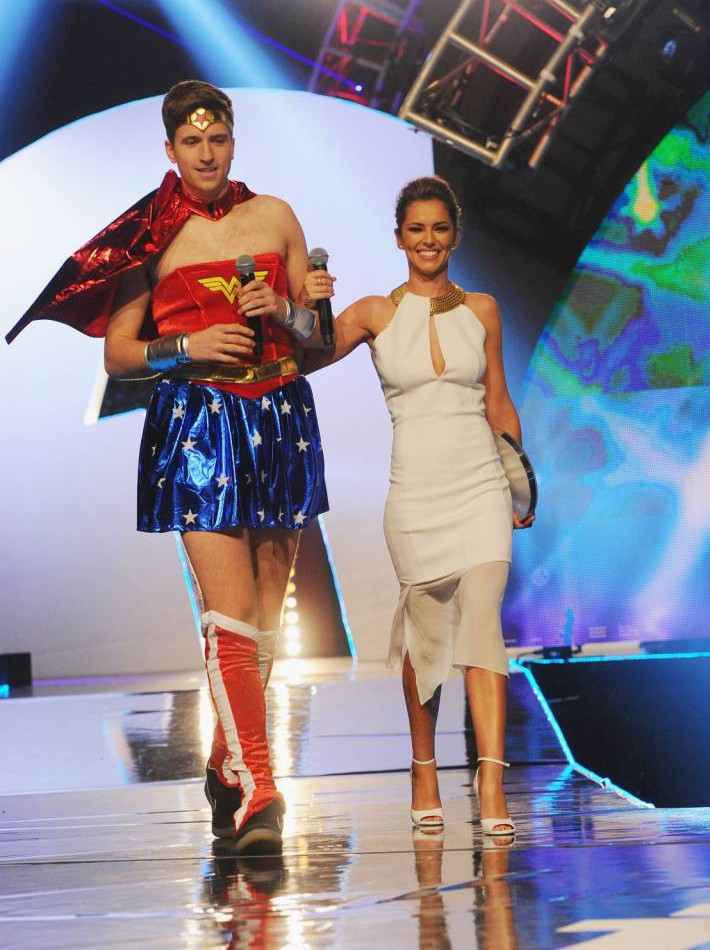 Cheryl Cole presents Radio One Teen Award on stage with Greg James in drag, because charity