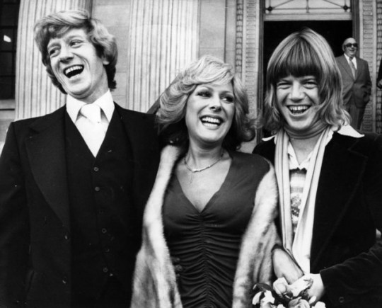 7th November 1975:  Film producer Greg Smith (left) with his bride actress Lynda Bellingham after their marriage, accompanied by the best man actor Robin Askwith.  (Photo by Chris Ware/Keystone/Getty Images)