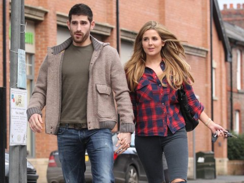 Rapist footballer pictured hand-in-hand with girlfriend