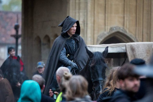 Benedict Cumberbatch plays Richard III during rehearsals for Richard III, one of three Hollow Crown films being made by BBC 2, at Wells Cathedral, Wells, Somerset.  See SWNS story SWKING; Sherlock Holmes star, Benedict Cumberbatch, has been spotted filming for his latest TV drama.  These shots show the 38-year-old in regal attire, posing as Richard III on a large mahogany throne.  Cumberbatch, who can normally be seen in a deerstalker hat while playing the famous TV detective is currently filming for the BBC2 series, The Hollow Crown. The latest scenes were filmed at Wells Cathedral, Somerset, providing an impressive back drop for the scenes. The latest four-part drama, which will not be aired until 2016, is based on William Shakespeareís history plays.