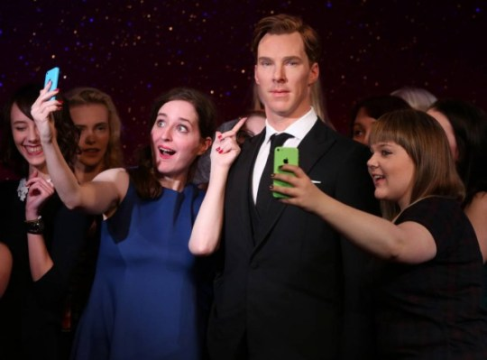 Fans takes selfies around the new wax figure of Benedict Cumberbatch as it is unveiled at Madame Tussauds in central London, Tuesday, Oct. 21, 2014. (Photo by Joel Ryan/Invision/AP)