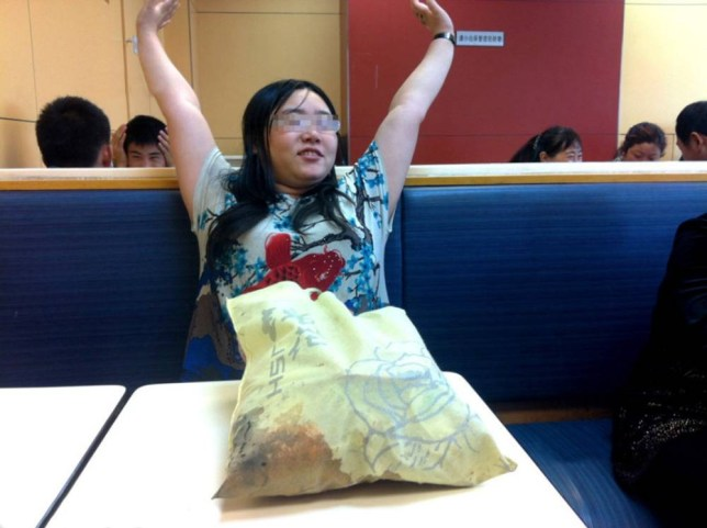 "Pic shows: Tan Shen who was dumped by her boyfriend decided to spend an entire week sitting in a KFC. A woman dumped by her boyfriend spent an entire week sitting in a KFC eating chicken wings. Depressed Tan Shen, 26, from Chengdu, in Chinaís southwest Sichuan Province, decided she needed some finger licking good comfort food to get over her ex and turned to what she enjoyed most - Kentucky Fried Chicken. She said: ""I was walking around feeling miserable and decided to stop off at the KFC at the train station. ""I hadnít planned on staying there long, I just wanted some chicken wings. ""But once I got in there and started eating I decided I needed time to think. ""I didnít want to go back to my apartment because it was full of memories of him. ""So I stayed."" After a few days employees at the chicken shop began to get concerned. Worker Jiang Li Lung, 22, said: ""We work in shifts here and the restaurant is open 24 hours a day, so we get a lot of people coming through. ""At first no one really noticed her. ""But after a few days I began thinking she looked really familiar. ""Then I realised we had been serving her for the past three days and that she hadnít actually left. ""When we asked her if she was ok, she said she was and just needed time to think. ""And then asked for another box of chicken wings with extra large fries."" He said the woman wasnít doing anyone any harm so they let her stay. He added: ""She was after all a paying customer, even if a bit of an odd one."" After a week Shen decided sheíd had enough when local media turned up and decided to write about her. ""I decided the best thing to do would be to leave the city and go back to my parents. ""I had already told work I was off sick, so phoned them and said I was leaving. ""And I was getting sick of the taste of chicken so there was no point in staying there anymore."" She then boarded the next train to her parents' home in Quingdao city in east Chinaís Shandong Province and left. Waitress Jiang Li Lung said: ""I guess we kind of miss her. It certainly made work more interesting."" (ends)¿¿ ¿¿¿¿¿¿¿¿¿¿"