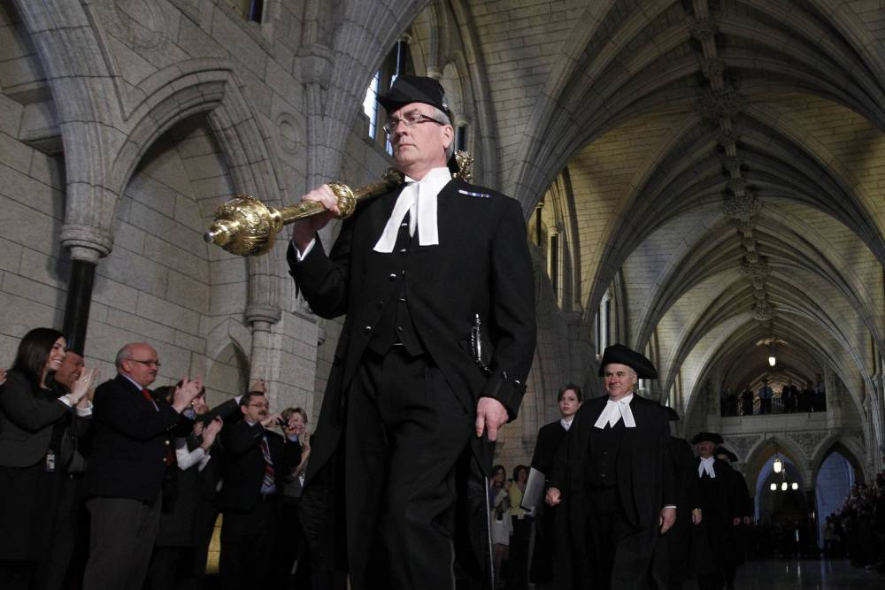 Sergeant-at-Arms Kevin Vickers is pictured in the Hall of Honour on Parliament Hill in Ottawa in this file photo from March 25, 2011.  According to Veterans Affairs Minister Julian Fantino, Vickers shot dead one of the suspects in the October 22, 2014 shooting incident on Parliament Hill.  A gunman shot and wounded a soldier in Ottawa and then entered the country's parliament buildings chased by police, with at least 30 shots fired.  REUTERS/Chris Wattie/Files  (CANADA - Tags: POLITICS CRIME LAW)