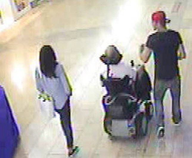 Handout CCTV still dated 25/07/14 issued by the Metropolitan Police of two suspects at Southside Shopping Centre in London, that they are looking for in connection with an assault on a man who was left with a broken jaw. PRESS ASSOCIATION Photo. Issue date: Tuesday October 28, 2014. The victim was walking home from work in Wandsworth, when he was shoved to the ground in an attack by two men. The police have released CCTV stills of the balding wheelchair user, who is aged 40 to 45, and the second man, who is aged 20 to 25 and was wearing a black t-shirt and a red baseball cap. See PA story POLICE Wheelchair. Photo credit should read: Metropolitan Police/PA Wire NOTE TO EDITORS: This handout photo may only be used in for editorial reporting purposes for the contemporaneous illustration of events, things or the people in the image or facts mentioned in the caption. Reuse of the picture may require further permission from the copyright holder.