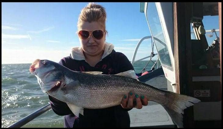 BNPS.co.uk (01202 558833) Pic: ShelleyBassett/BNPS ***Please Use Full Byline*** Shelley's first bass (6lbs), caught October 20th 2014, on a bot off of the coast of Ramsgate.  A sexism row has forced organisers of a prestigious angling championship to change the rules after a female competitor felt there was something fishy about the prize money. Shelley Bassett won the women's category at the British Open Sea Fishing Championship in 2011 and 2012, but was disappointed when she received a paltry £25 - compared to £1,000 handed to the male winner. She complained to organisers, Deal Angling Club 1919, who argued it wasn't a sexism issue.  They told her women could win the overall £1,000 prize but no one had ever done so they created a women's category to give the female competitors a chance of netting a prize. But Miss Bassett wasn't satisfied with this answer as that meant women then had an unfair advantage, with the chance to win two prizes. She kept up the fight for fairness and has now been rewarded after new rules were brought in for the 2014 championships, which took place earlier this month.
