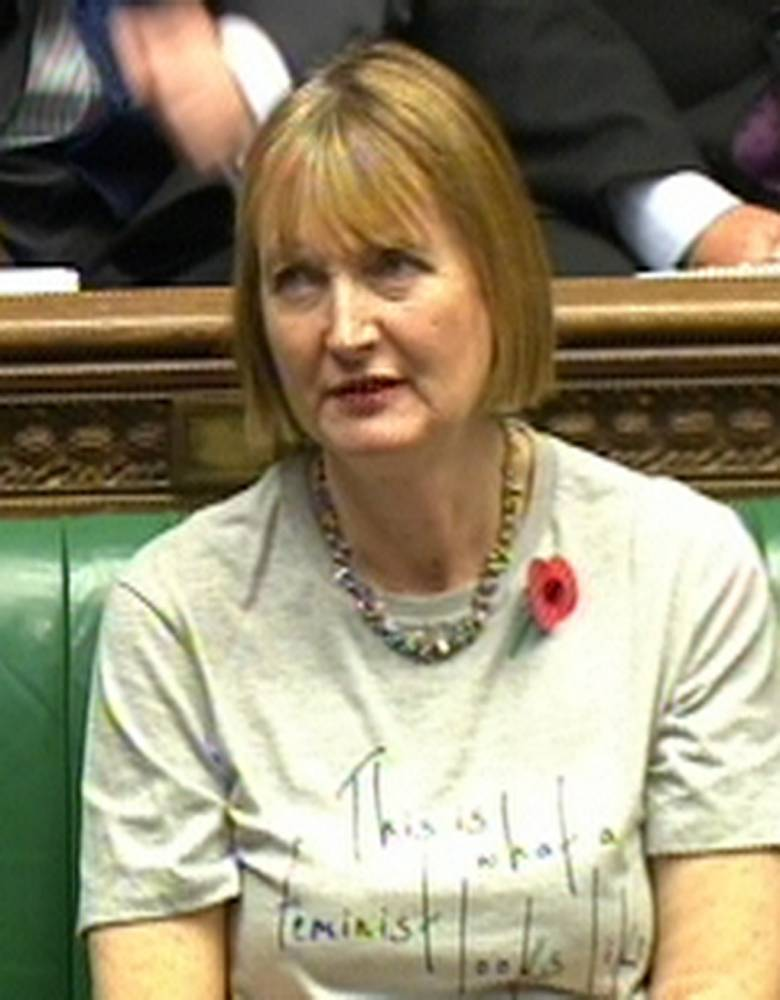 Deputy leader of the Labour party Harriet Harman wears a feminist T-shirt during Prime Minister's Questions in the House of Commons, London. PRESS ASSOCIATION Photo. Picture date: Wednesday October 29, 2014. Photo credit should read: PA/PA Wire