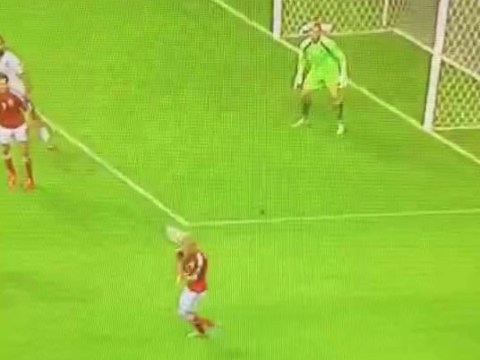 Daniel Agger's clearance knocks out Denmark teammate Nicolai Boilesen during Portugal clash
