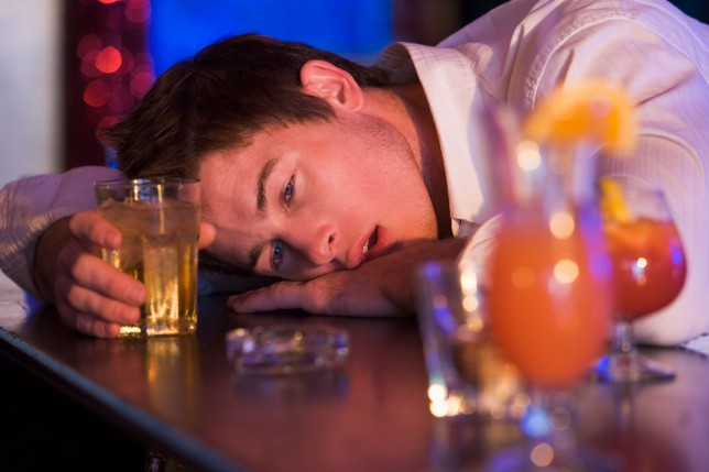 B4N5BA Drunk young man passed out in bar