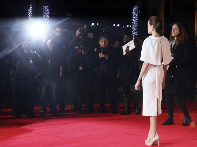 """Director Angelina Jolie poses for a photograph as she arrives for the UK premiere of """"Unbroken"""" in central London (Picture: Paul Hackett/Reuters)"""