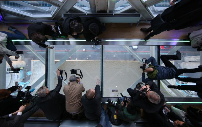 LONDON, ENGLAND - NOVEMBER 10:  Photographers get a unique view of the River Thames from Tower Bridge's new glass walkway on November 10, 2014 in London, England. Unveiled today the glass floor panels along the bridge's high-level walkways weigh 300 kgs each, cost £1m and will give visitors a new view over the historic bridge crossing The River Thames.  (Photo by Peter Macdiarmid/Getty Images)