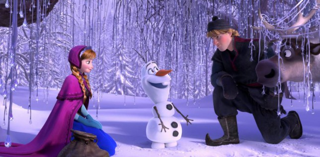 """Film: Frozen (2013).  This image released by Disney shows, from left, Anna, voiced by Kristen Bell, Olaf, voiced by Josh Gad, and Kristoff, voiced by Jonathan Groff in a scene from the animated feature """"Frozen.""""   (AP Photo/Disney)"""