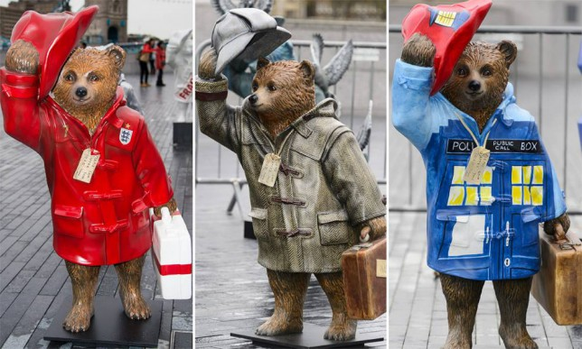 LONDON, ENGLAND - NOVEMBER 03:  The 'Golden Paws' Paddington Bear stature designed by David Beckham stands at the launch of The Paddington Trail at The Scoop, More London on November 3, 2014 in London, England.  (Photo by Ian Gavan/Getty Images)
