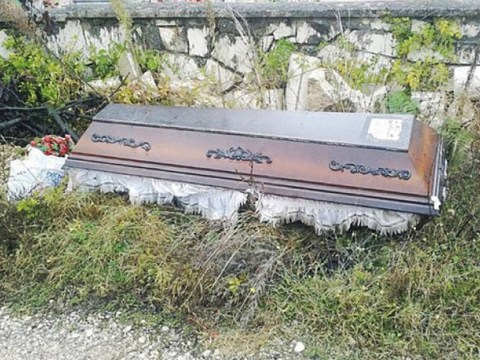 Widow digs up husband's body before dumping coffin on roadside