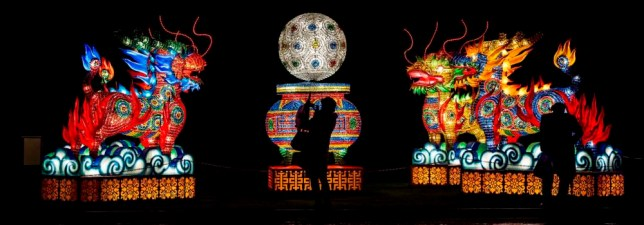 Visitors look at illuminated Chinese lanterns at an art installation at the Festival of Light in Longleat, Wiltshitre, where 20 giant displays of Chinese lanterns are open to the public from Friday 14th November. PRESS ASSOCIATION Photo. Picture date: Wednesday November 12, 2014. Photo credit should read: Ben Birchall/PA Wire