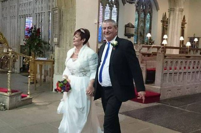 A married couple had their silver wedding celebrations ruined by a pack of drunken yobs who gatecrashed their party. Jimmy and Tracie Cowan had their anniversary party wrecked by the group of up to 50 drunks on a rugby club outing. The pair had just renewed their vows when the thugs tried to force their way into their party at an ex-serviceman's club.  Pictured here are the couple renewing their vows on the day. © WALES NEWS SERVICE