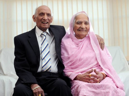File p[icsture shows Britains oldest couple Mr Karam Chand aged 109 and Mrs Kartari aged 102, pictured in Bradford. See Ross Parry copy RPYOLD : A British husband and wife who are the world's oldest married couple have celebrated their joint birthdays - with a combined age of 211.  Karam Chand reached 109 on the same day his wife of nearly 90 years turned 102.  The lovebirds celebrated birthdays among four generations of family at their home in Bradford, West Yorks., on Sunday. The golden oldies claim to be the world's oldest married couple, tying the knot 89 years ago in December 1925 after meeting in India as teenagers.  Son Paul Chand said he was proud to help his parents celebrate nearly a century of married life.