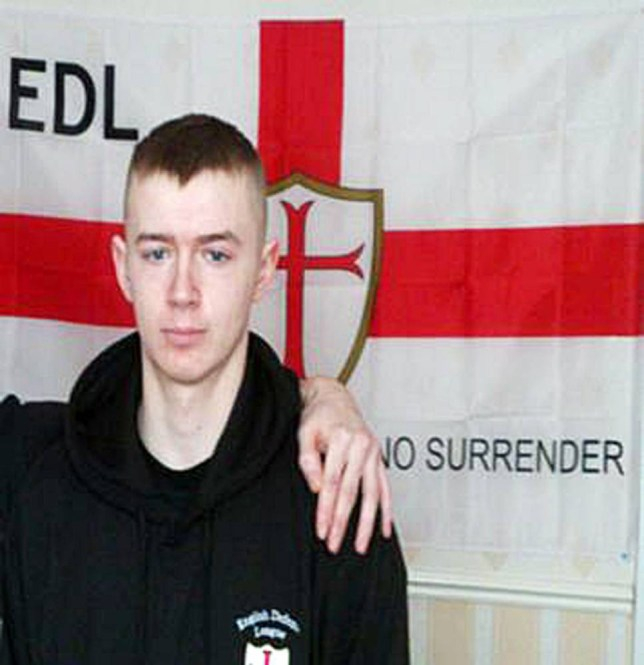 BEST QUALITY AVAILABLE Undated handout photo issued by Greater Manchester Police of Ryan McGee, in front of an EDL flag, as he has been jailed for two years for making a viable nail bomb packed with deadly shrapnel in his bedroom in Eccles, near Manchester. PRESS ASSOCIATION Photo. Issue date: Thursday July 25, 2013. The young rifleman who was obsessed with far-right politic made a device which contained 181 metal screws and bits of glass which were designed to maximise wounding capability when it was set off. See PA story COURTS Rifleman. Photo credit should read: Greater Manchester Police/PA Wire NOTE TO EDITORS: This handout photo may only be used in for editorial reporting purposes for the contemporaneous illustration of events, things or the people in the image or facts mentioned in the caption. Reuse of the picture may require further permission from the copyright holder.