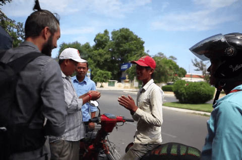 Couple bike from Vietnam to Cambodia before donating their motorbike to a street seller