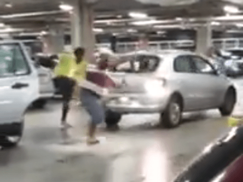 Driver puts car into reverse and proves parking rage is a very real phenomenom