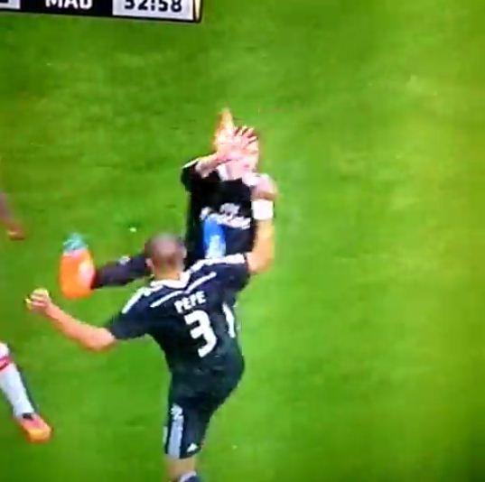 Pepe does a Nigel de Jong after karate kicking Real Madrid teammate Sergio Ramos during Granada win