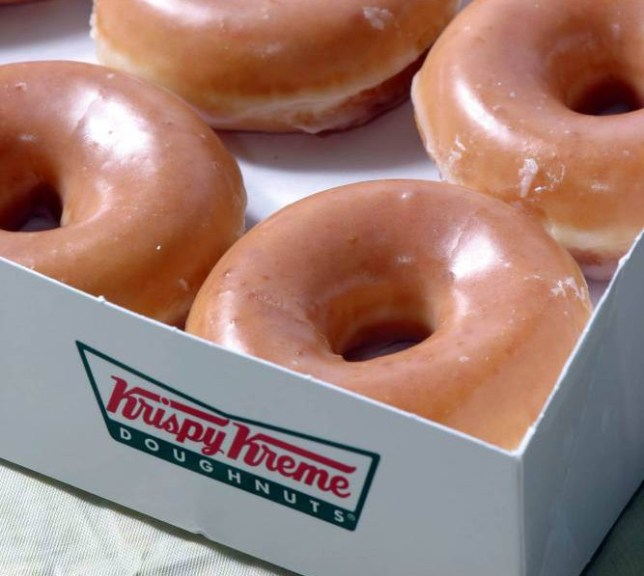 Krispy Kreme glazed dougnuts are shown, Wednesday, Nov. 10, 2004, in Charlotte, N.C. Krispy Kreme Doughnuts Inc. announced Tuesday, Feb. 8, 2005, it is working to avoid a financing crunch this spring, cutting about 125 jobs and jettisoning its corporate jet as it aims to conserve cash. (AP Photo/Nell Redmond)