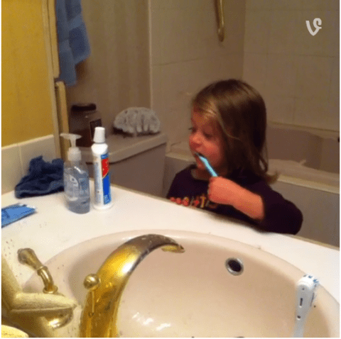 Dad offers daughter questionable advice as she brushes her teeth