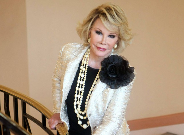 "FILE - This Oct. 5, 2009 file photo shows Joan Rivers posing as she presents ""Comedy Roast with Joan Rivers "" during the 25th MIPCOM (International Film and Programme Market for TV, Video, Cable and Satellite) in Cannes, southeastern France. State health investigators say the Manhattan clinic where Rivers suffered a fatal complication during a medical procedure made several errors, including failing to keep proper medication records and snapping cell phone photos of her while she was unconscious. The comedian, who was 81, died Sept. 4, 2014. (AP Photo/Lionel Cironneau, File) AP Photo/Lionel Cironneau, File"