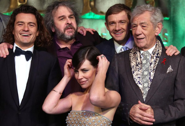 From top left, actor Orlando Bloom, director Peter Jackson, actor Martin Freeman, Sir Ian McKellen and Evangeline Lilly, front, pose for photographers upon arrival at the World premiere of the film The Hobbit, The Battle of the Five Armies in London, Monday, Dec. 1, 2014. (Photo by Joel Ryan/Invision/AP) Joel Ryan/Invision/AP