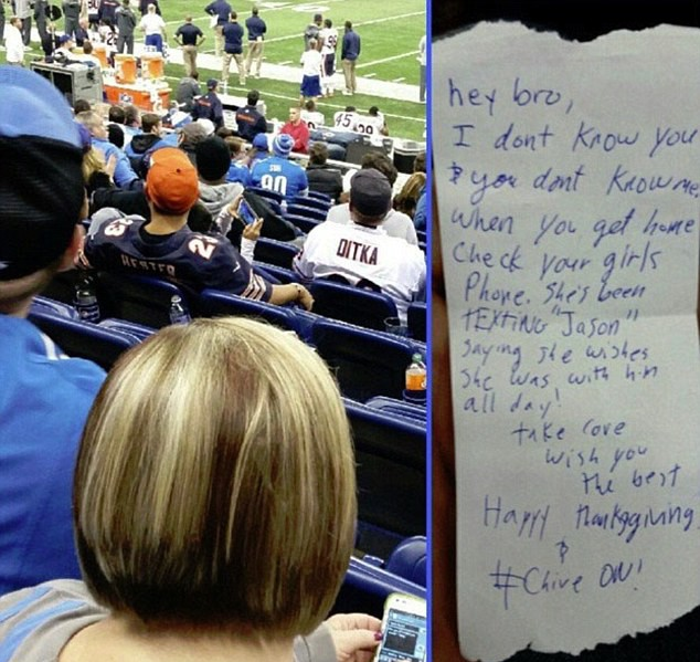 American football fan passes note to man in front telling him his girlfriend is a 'cheat'