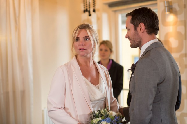 EastEnders: It's the day of Ronnie and Charlie's wedding but will everything go to plan.  Ronnie Mitchell (SAMANTHA WOMACK), Charlie Cotton (DECLAN BENNETT)