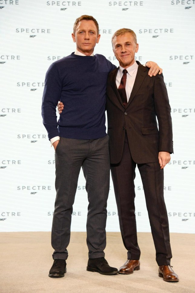 IVER HEATH, ENGLAND - DECEMBER 04: (EMBARGOED FOR PUBLICATION IN UK TABLOID NEWSPAPERS UNTIL 48 HOURS AFTER CREATE DATE AND TIME. MANDATORY CREDIT PHOTO BY DAVE M. BENETT/WIREIMAGE REQUIRED) Daniel Craig (L) and Christoph Waltz attend a photocall with cast and filmmakers to mark the start of production which is due to commence on the 24th Bond Film and announce the title of the film as 'Spectre' at Pinewood Studios on December 4, 2014 in Iver Heath, England. Dave M. Benett/WireImage