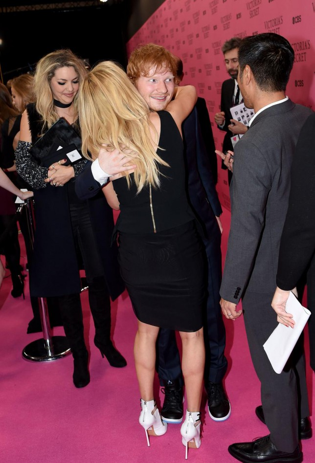 Awkward: Exes Ellie Goulding and Ed Sheeran share a hug at Victoria's Secret Fashion Show