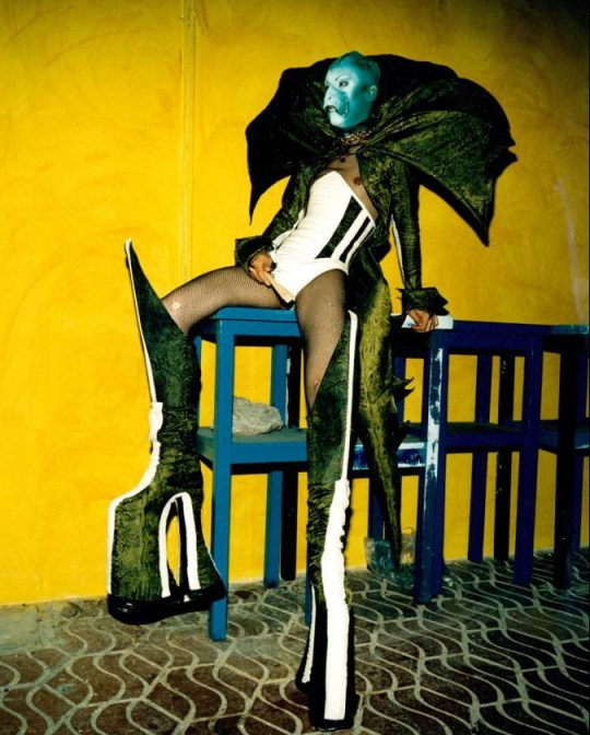 Mandatory Credit: Photo by Dean Chalkley/PYMCA /REX (3489956a)  Trannie clubber in alien face paint, bodice, fishnet tights and massive platform boots, Ibiza 1999  STOCK