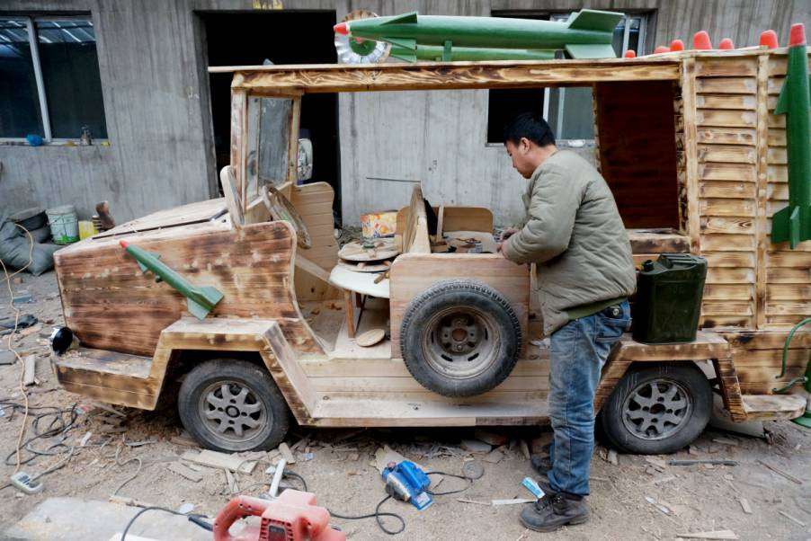 This wooden electric car equipped with rockets looks extremely manly