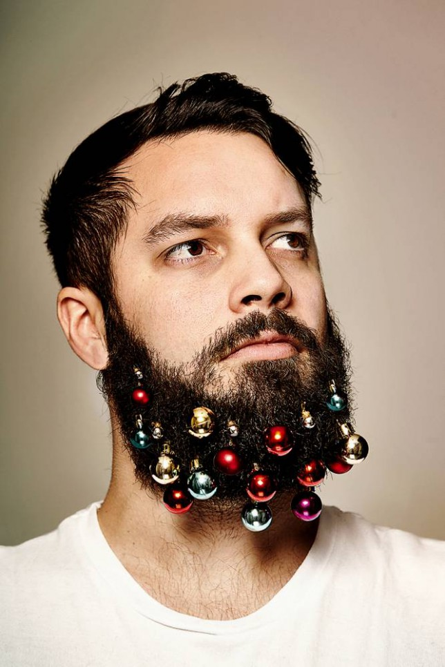 A model poses with beard baubles, the latest facial hair craze this Christmas. An Advertising Agency from London has been selling BEARD BAUBLES ñ for the man wanting to add an extra festive touch to his whiskers.  The Yuletide facial hair accessory ñ which retails for GBP5.00 ñ has been flying off shelves in the UK. Ö PIC BY NEWS DOG MEDIA - 0121 246 1932 Ö SEE COPY