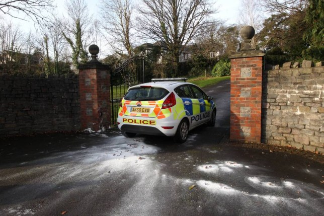 Police enter the house of Shrien Dewani's family home on 11 December 2014. The businessman was cleared in South Africa of arranging the murder of his new wife.